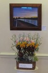 "Anne Manners's floral interpretation of WSA artist Robin L.Carroll's pastel ""The Way Home"""