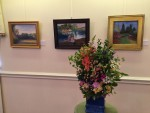 "Artists: Robin Carroll ""Meet Me in the Garden"" Pastel & Helen Turner ""Visitors"", Acrylic & Michelle Lavallee ""Field in September"" Oil; Floral by Cindy Jaczko (House and Garden Club)"